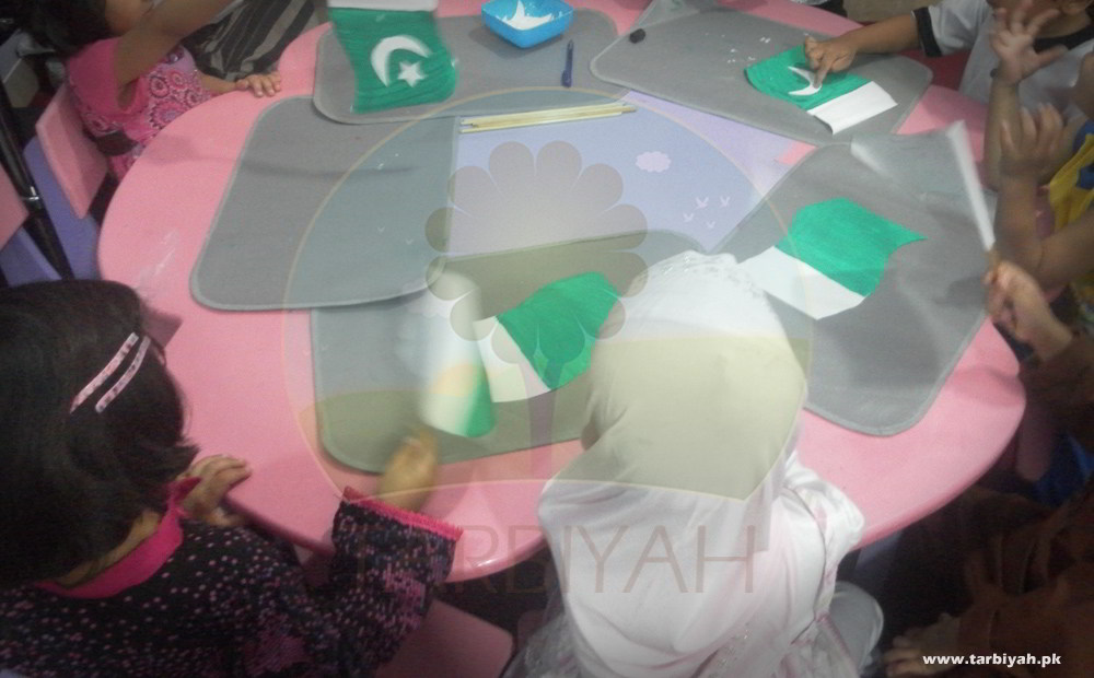 Kids on table making Pakistan flag